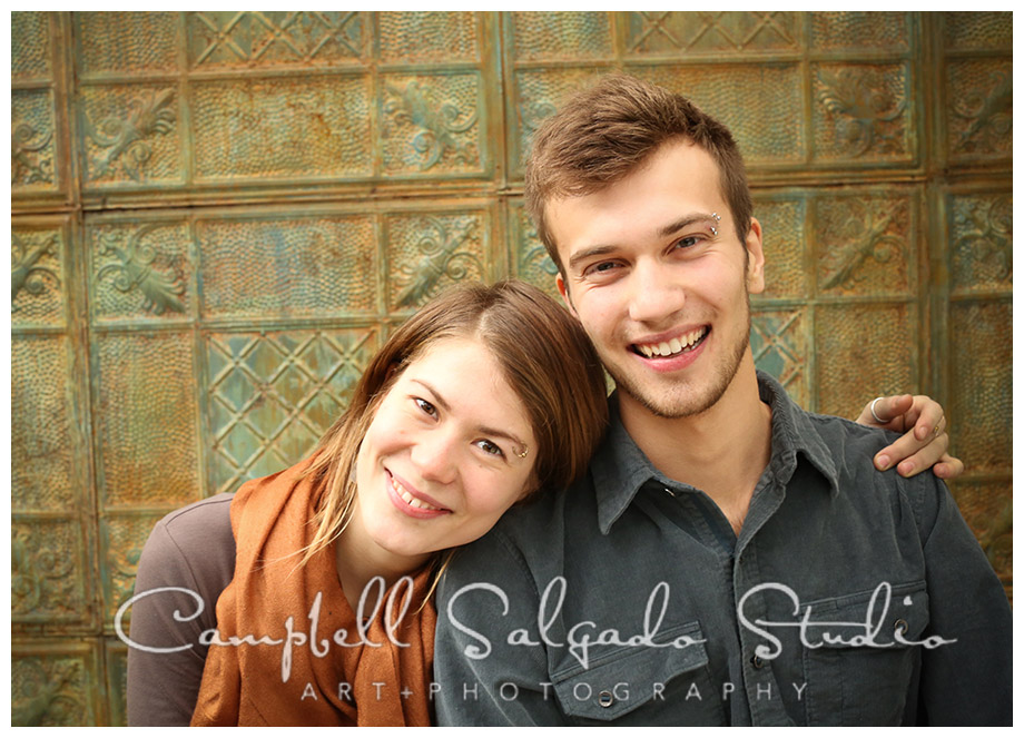 Portrait of siblings on vintage tin background in Portland, Oregon at Campbell Salgado Studio.