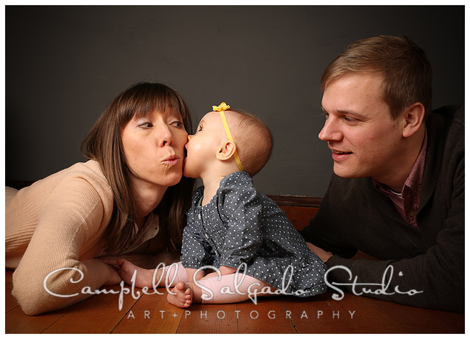 Portrait of young family on grey background at Campbell Salgado Studio in Portland, Oregon.