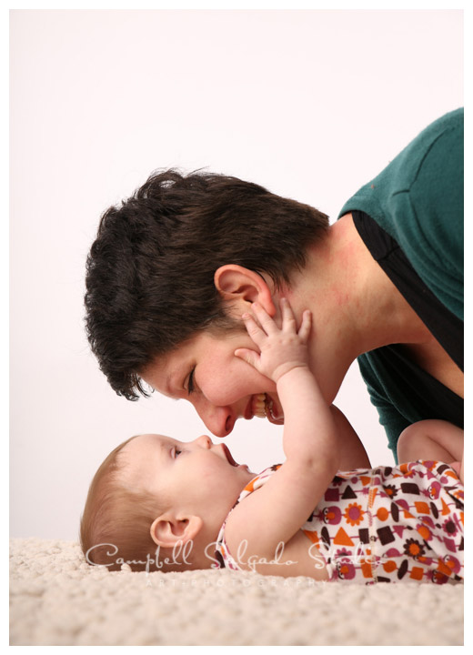 Portrait of baby and mama on white background at Campbell Salgado Studio.