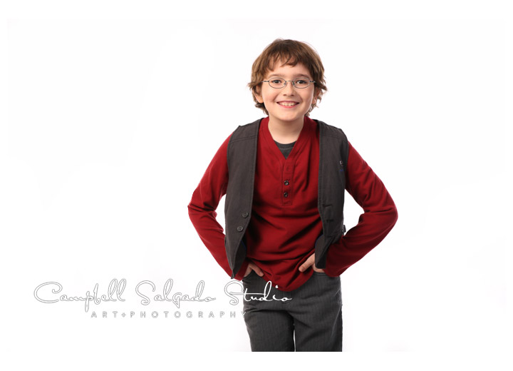 Portrait of boy on clean, white background at Campbell Salgado Studio.