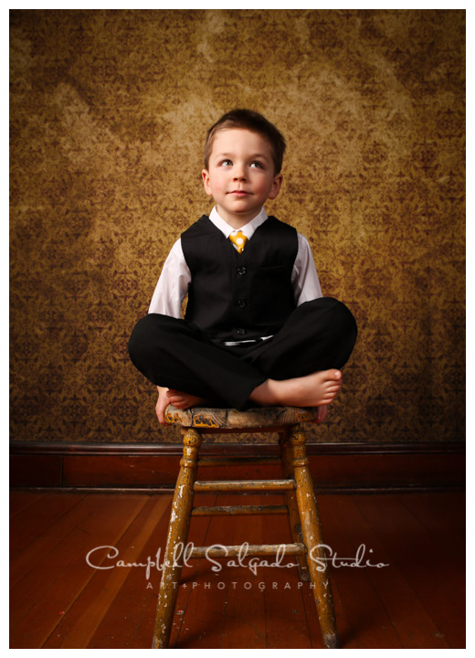 Portrait of young boy on vintage yellow background at Campbell Salgado Studio.