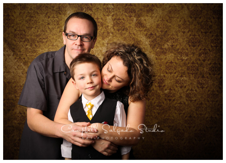 Portrait of family on vintage yellow background at Campbell Salgado Studio.