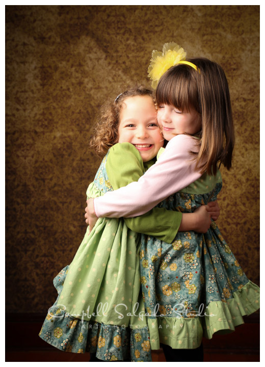 Portrait of twin girls on vintage yellow background at Campbell Salgado Studio.