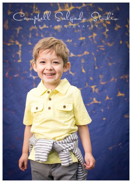 "Portrait of boy on ""Frida"" background at Campbell Salgado Studio in Portland, Oregon."