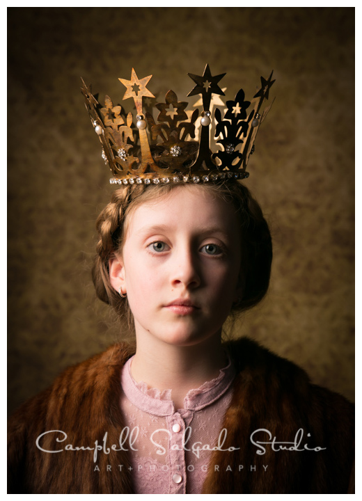 Portrait of girl in crown on amber background at Campbell Salgado Studio.