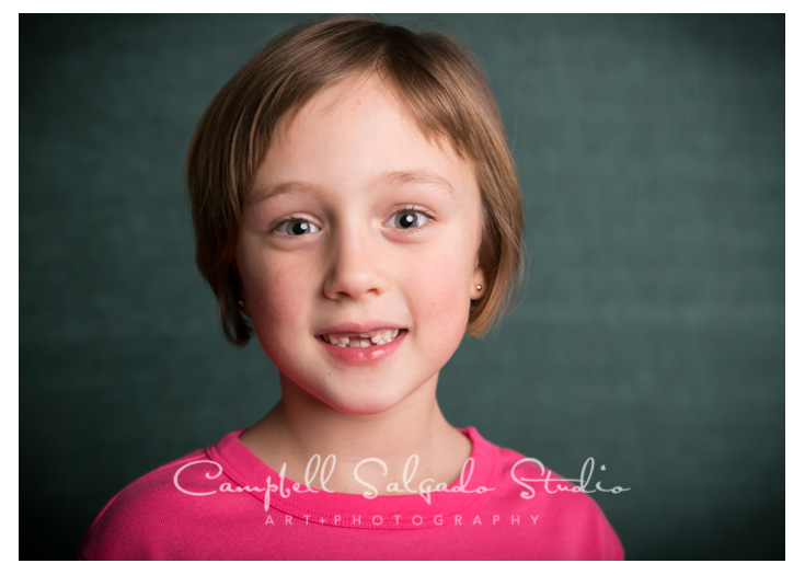 Portrait of girl on teal background at Campbell Salgado Studio.