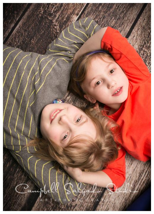 Portrait of kids on wooden floor at Campbell Salgado Studio.