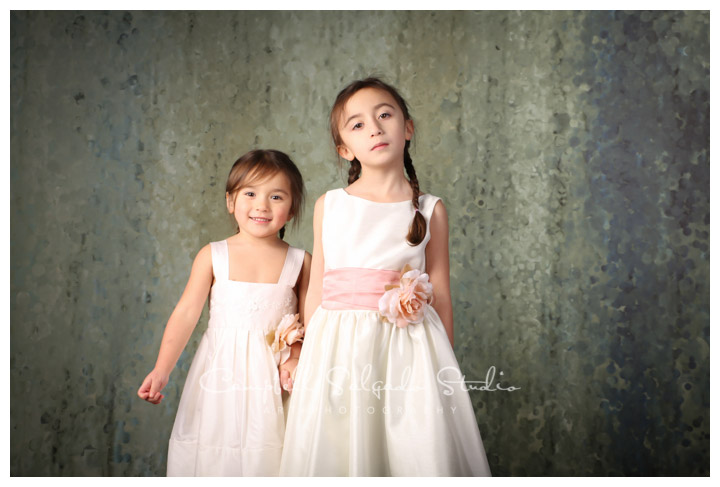 Portrait of sisters on rainy, green background at Campbell Salgado Studio in Portland, Oregon.