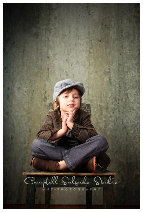 Portrait of boy on rainy, green background at Campbell Salgado Studio.