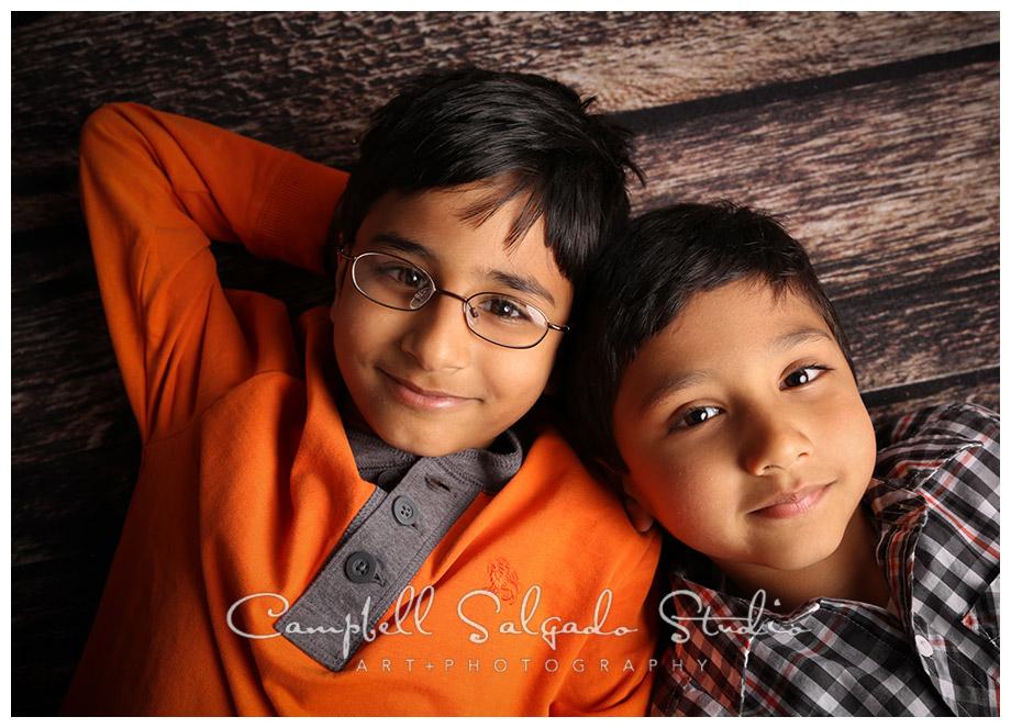 Portrait of boys on wooden floor at Campbell Salgado Studio.