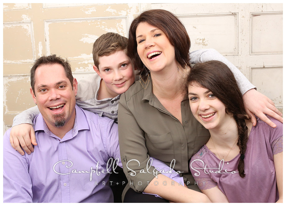 Portrait of family on vintage doors background at Campbell Salgado Studio.