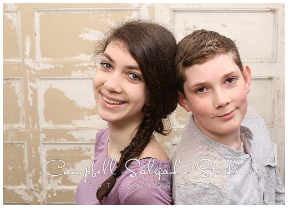 Portrait of siblings on vintage doors background at Campbell Salgado Studio.