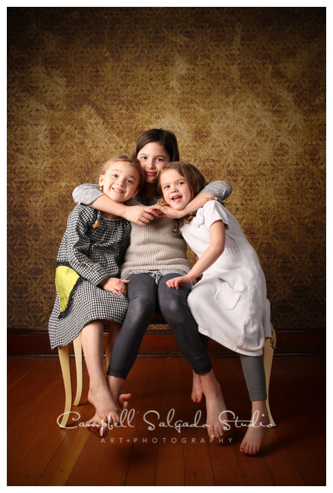 Portrait of sisters on vintage amber background at Campbell Salgado Studio in Portland, Oregon.
