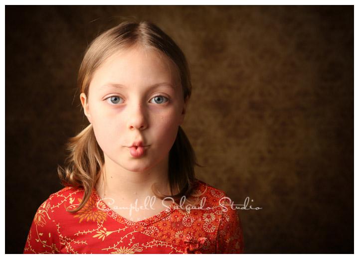 Portrait of girl on vintage amber background at Campbell Salgado Studio.