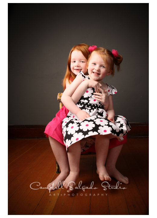 Portrait of sisters on grey background in Portland, Oregon at Campbell Salgado Studio.