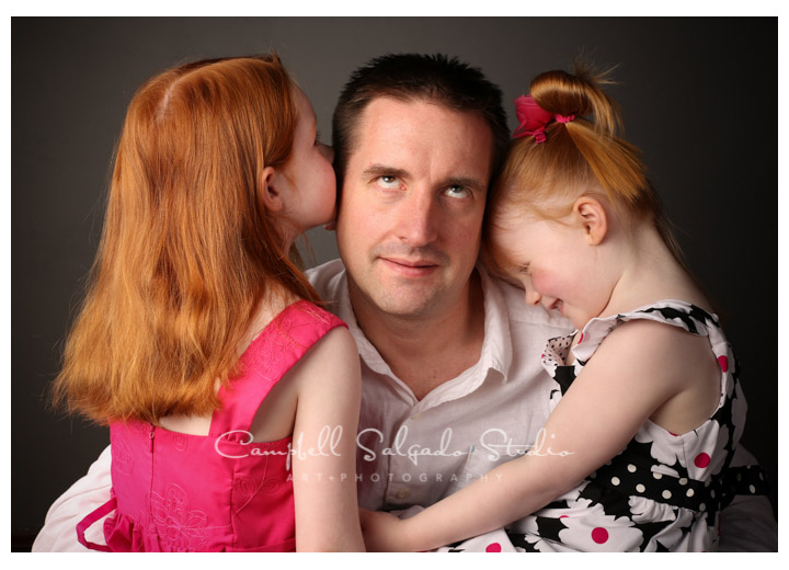 Portrait of dad with daughters on watery green background at Campbell Salgado Studio.