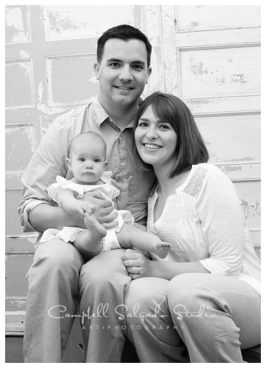 Portrait of  young family on vintage doors background at Campbell Salgado Studio .