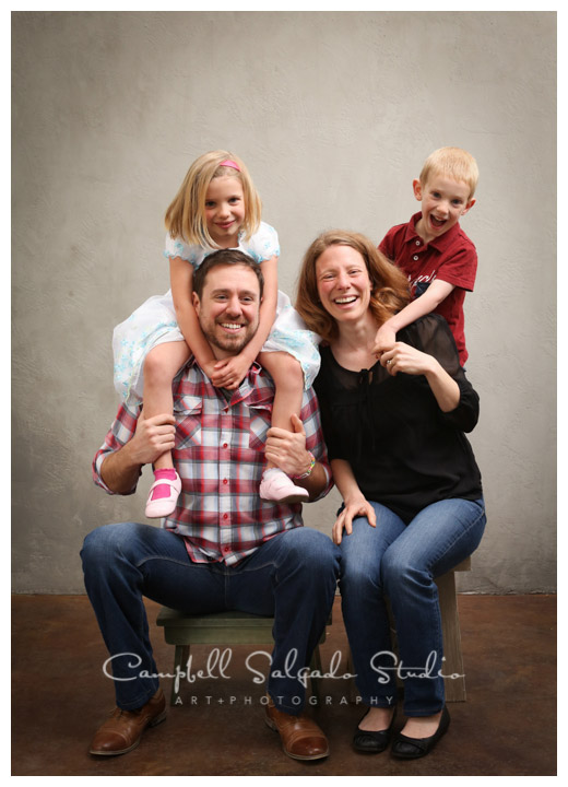 Portrait of family on light grey background at Campbell Salgado Studio in Portland, Oregon.