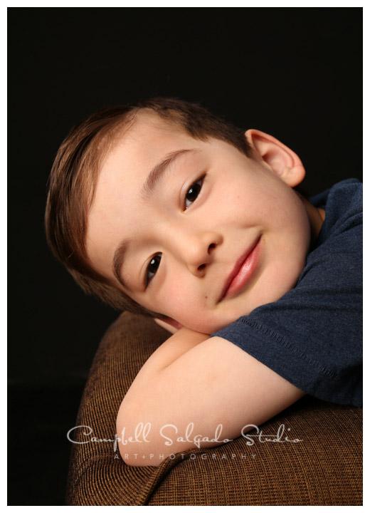 Portrait of boy on black background at Campbell Salgado Studio in Portland, Oregon.