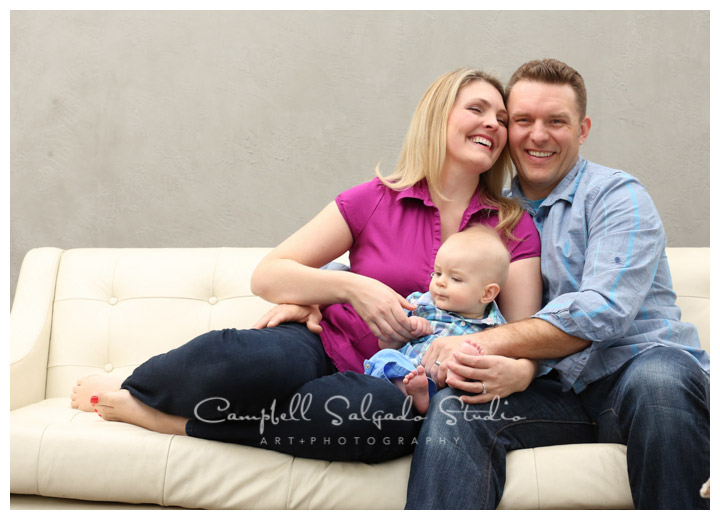 Portrait of family on light grey background at Campbell Salgado Studio.