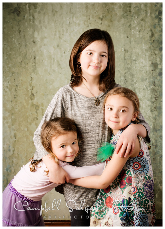 Portrait of sisters on watery green background at Campbell Salgado Studio.