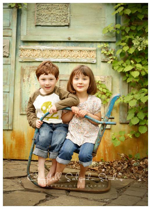 Portrait of siblings on vintage doors background at Campbell Salgado Studio in Portland, Oregon.