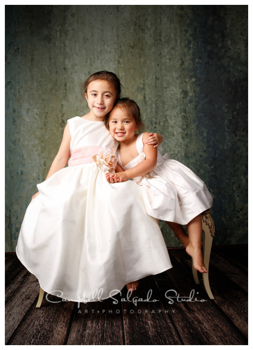 Portrait of sisters on rainy green background at Campbell Salgado Studio.