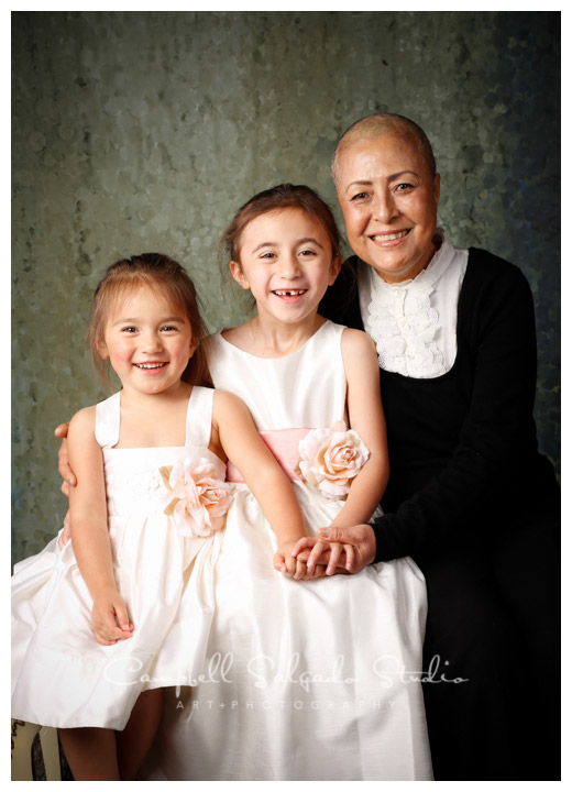 Portrait of grandmother and granddaughters on rainy green background at Campbell Salgado Studio.