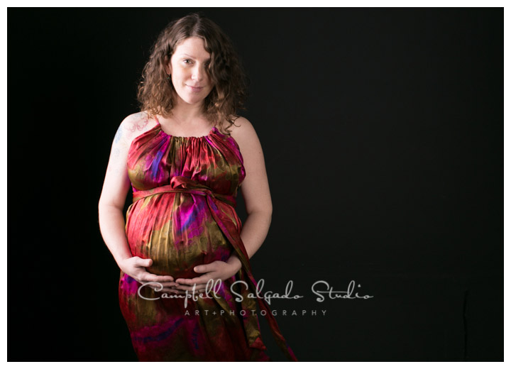Portrait of pregnant woman on black background at Campbell Salgado Studio.