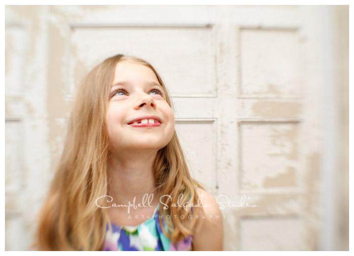 Portrait of girl on vintage doors background at Campbell Salgado Studio.