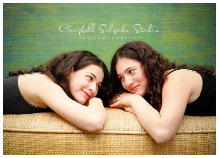 Portrait of sisters on green weave background at Campbell Salgado Studio.