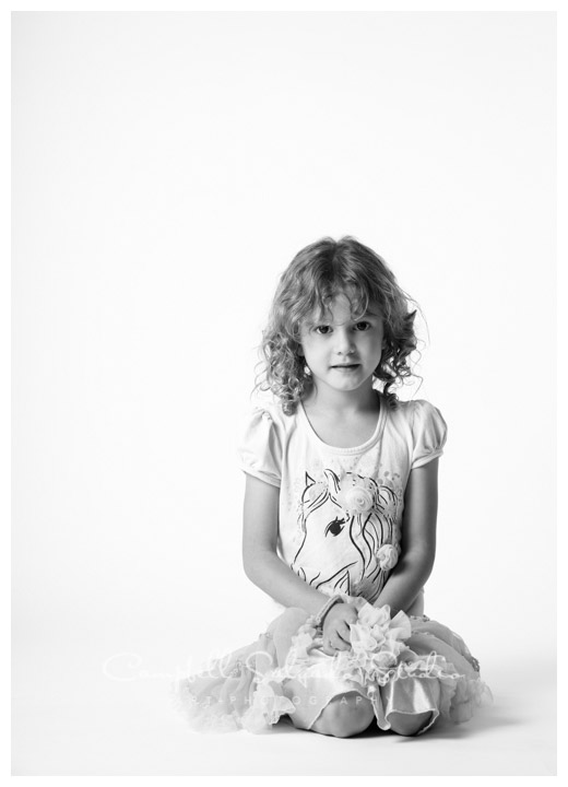 B&W portrait of girl on white background at Campbell Salgado Studio.
