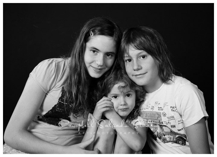 B&W portrait of children on black background at Campbell Salgado Studio.