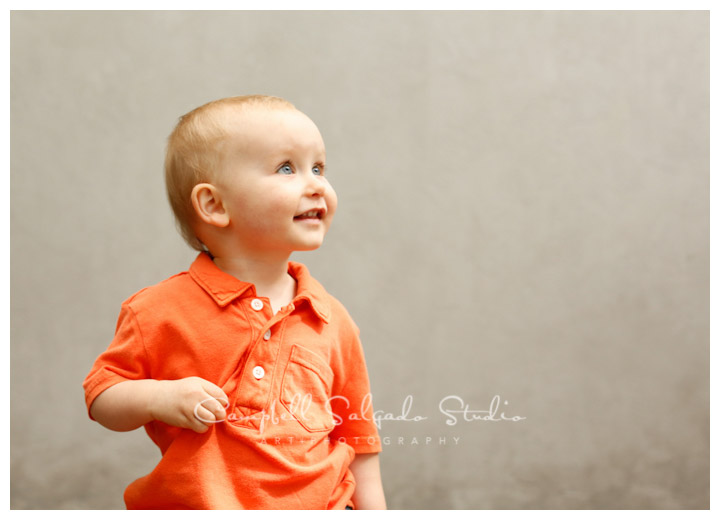 Portrait of boy on modern grey background at Campbell Salgado Studio.