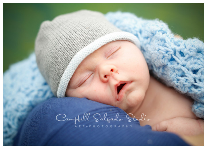 Portrait of infant on green weave background at Campbell Salgado Studio.