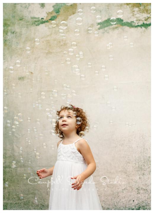 Portrait of girl on distressed concrete background at Campbell Salgado Studio.