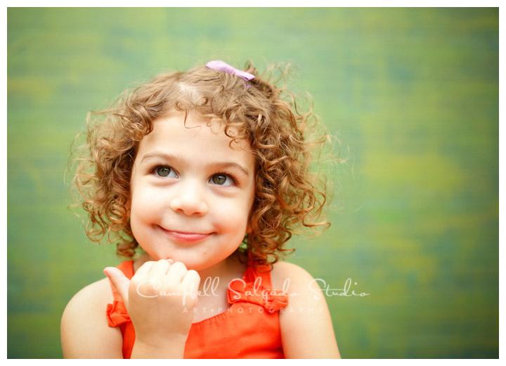 Portrait of girl on green weave background at Campbell Salgado Studio.