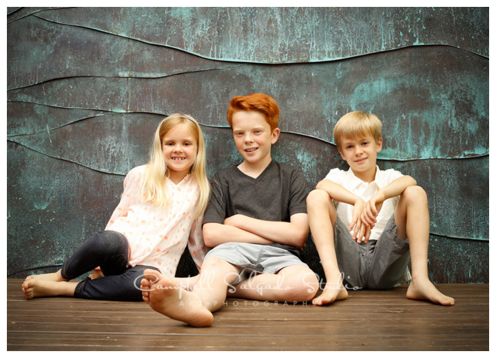 Portrait of children on copper background at Campbell Salgado Studio.