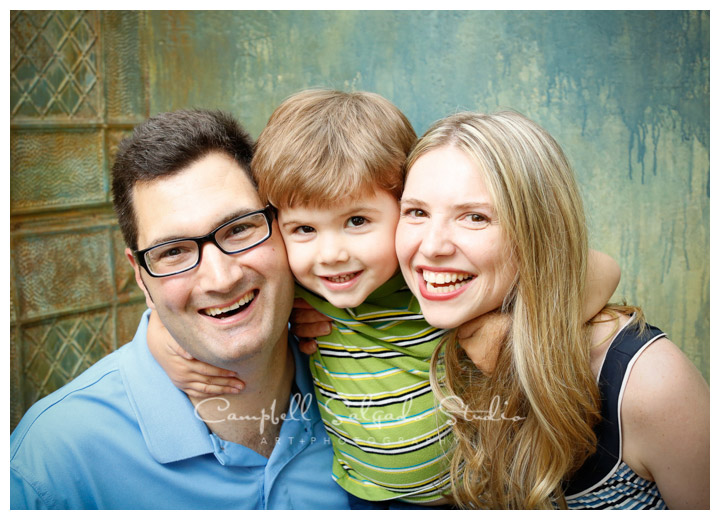 Portrait of family on tin background at Campbell Salgado Studio.