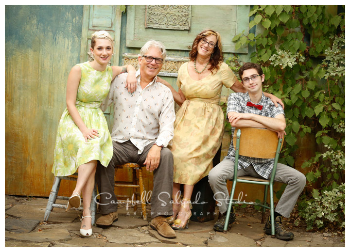 Portrait of family on vintage green doors background at Campbell Salgado Studio.