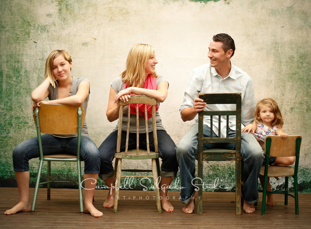 Portrait of family on distressed green background at Campbell Salgado Studio.