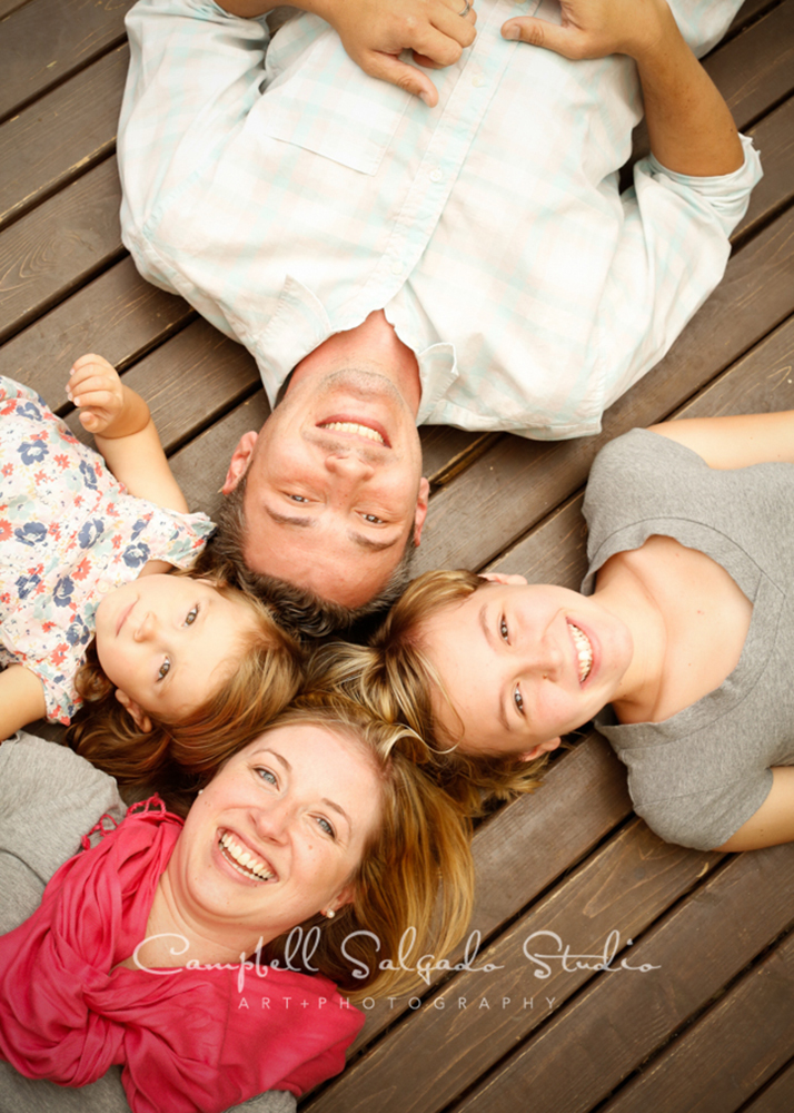 Portrait of family on wooden floor background at Campbell Salgado Studio.