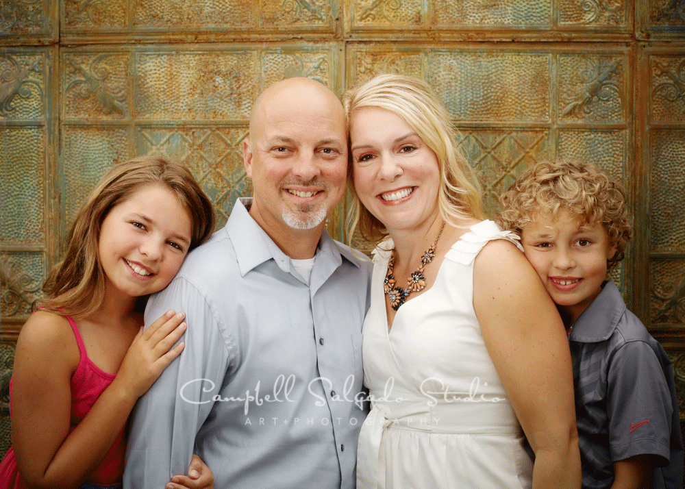 Portrait of family on rustic door on vintage colored tin background by family photographers at Campbell Salgado Studio, Portland, Oregon.