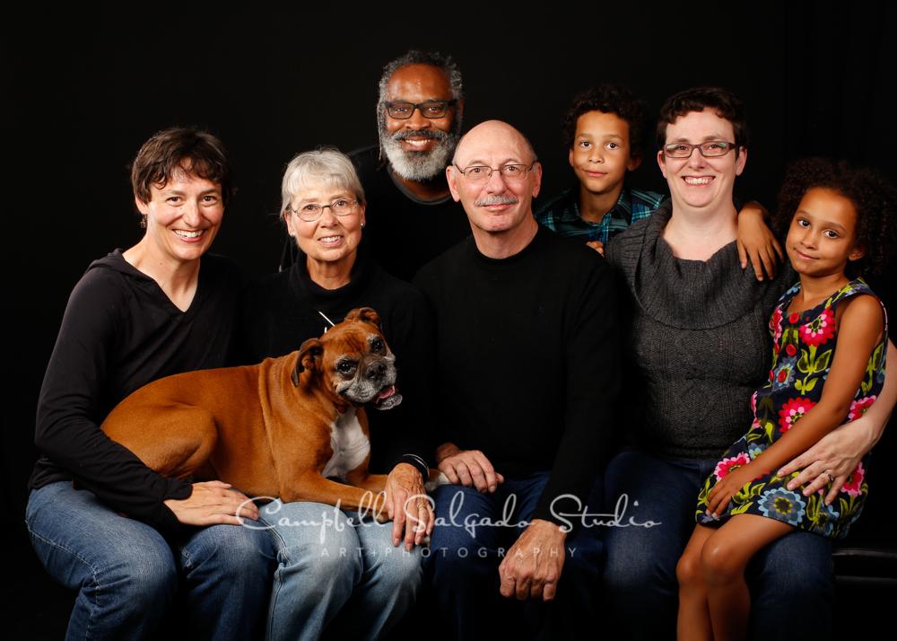 Portrait of multi generational family on black background by family photographers at Campbell Salgado Studio, Portland, Oregon