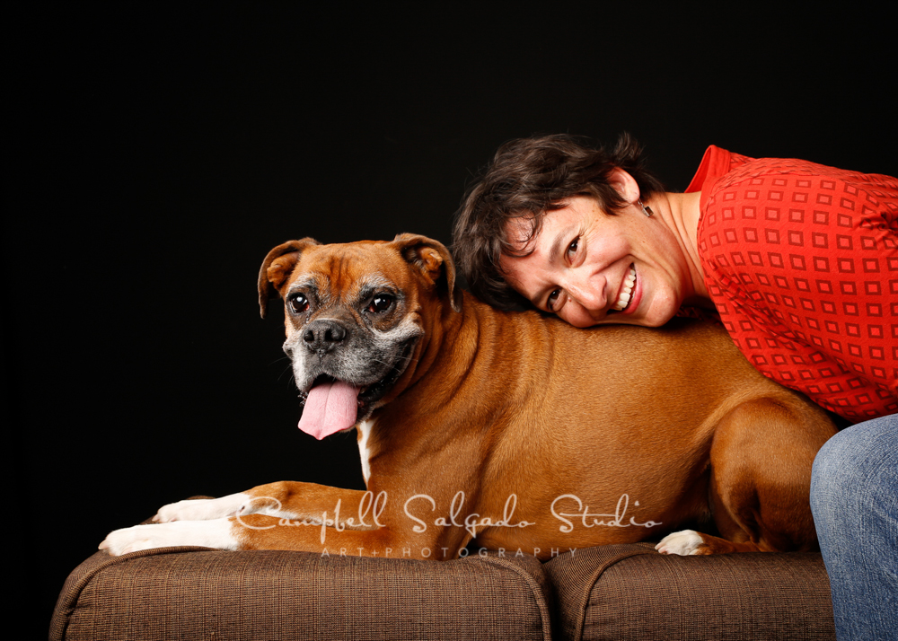 Portrait of woman and dog on black background by pet photographers at Campbell Salgado Studio, Portland, Oregon