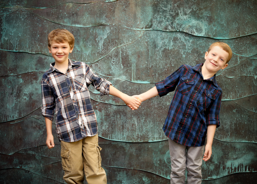 Portrait of brothers on copper wave background by childrens photographers at Campbell Salgado Studio, Portland, Oregon.