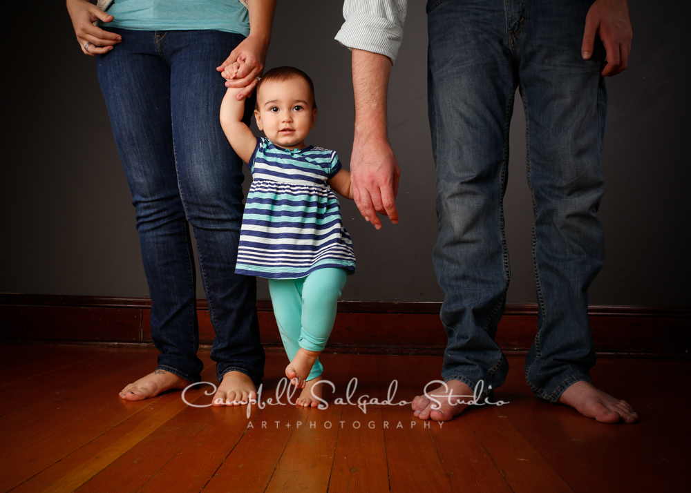 Portrait of little girl on gray background by childrens photographers at Campbell Salgado Studio, Portland, Oregon.