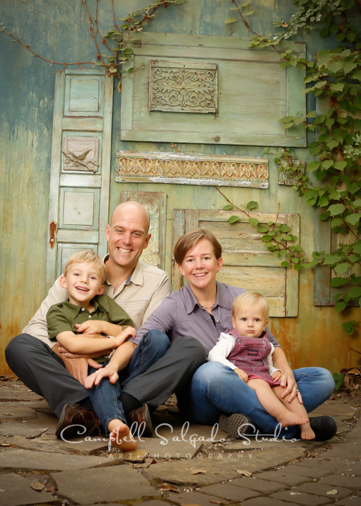 Portrait of family on vintage green doors by family photographers at Campbell Salgado Studio, Portland, Oregon.