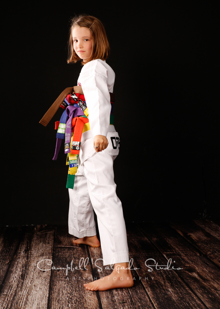 Portrait of girl in Tai Kwon Do gear on black background by child photographers at Campbell Salgado Studio, Portland, Oregon.
