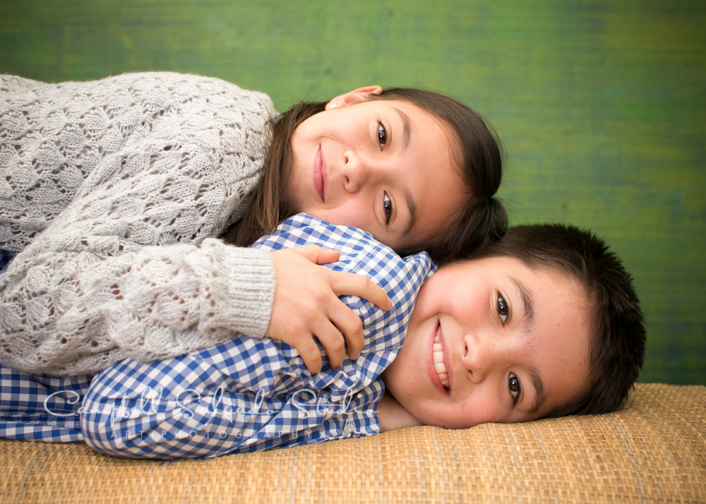 Portrait of kids on blue green weave background by  children's photographers at Campbell Salgado Studio, Portland, Oregon.